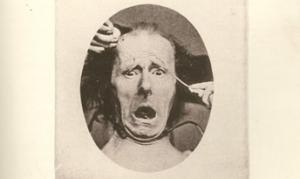 Image of a picture from Darwin's book on emotions showing a man with a fearful face.